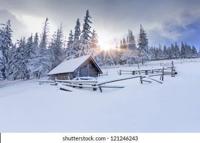 Old farm in the mountains at winter