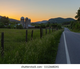 A old farm in Pownal Vermont with the sunset behind it.