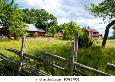Old farm in Smaland, Sweden, with originally red painted buildings and traditional wooden fence