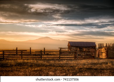 Old farm at sunset in Colorado.