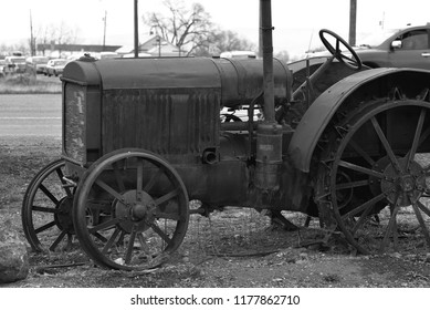 Old farm tractor in black and white