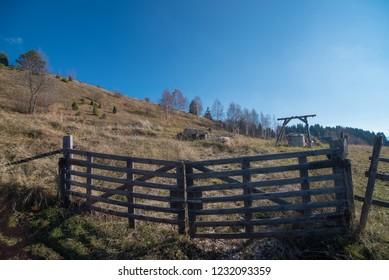 Old farm wooden fence door