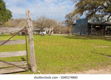 an old farm yard and fence in disrepair