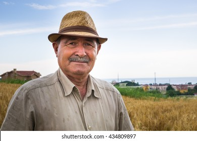 Old farmer looking to the camera