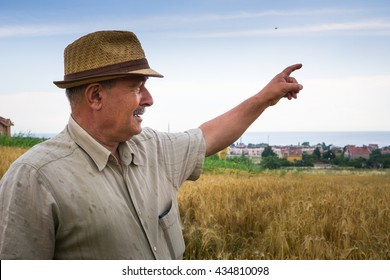 Old farmer pointing out a place