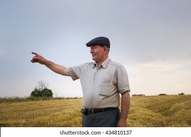 Old farmer raising his finger
