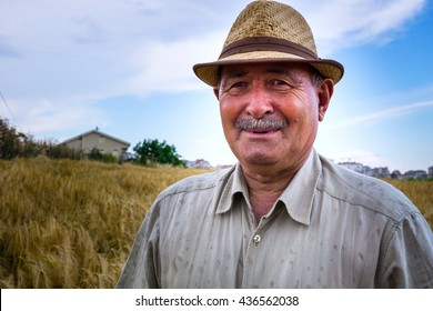 Old farmer smiling to the camera