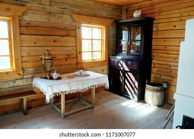 Old farmhouse kitchen interior in old country house, fireplace & vintage table. Ancient kitchen. Living room in rustic village retro style farm hut home. Traditional wooden cottage kitchen interior