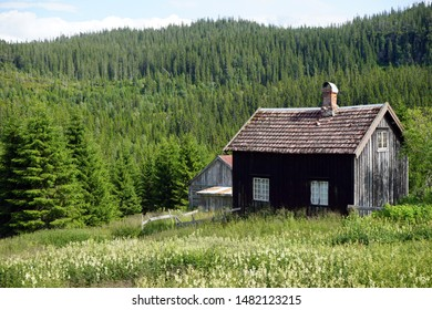 Old farmhouse near forest in Norway