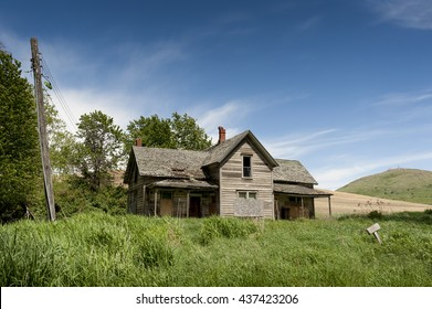 Old Farmhouse. In the palouse area of eastern Washington state there are many old abandoned and dilapidated farmhouses left to decay somewhat reminiscent of the dust bowl of the 1930's.