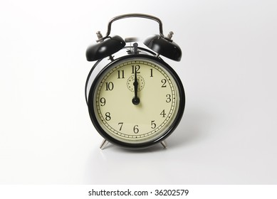 Old fashion alarm clock ringing at twelve o`clock