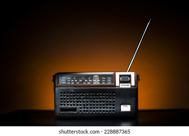 Old Fashion Brown Radio in a leather case on brown background.