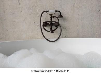 Old fashion faucet over jacuzzi bath tub