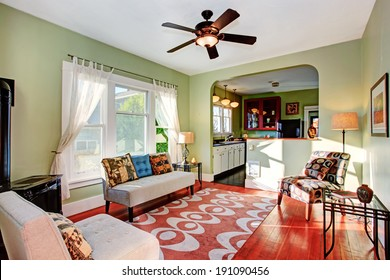Old fashion living room with antique couch. View of kitchen room