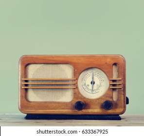 Old fashion style vintage radio over retro mint background with copyspace design. Hipster design audio music radio.