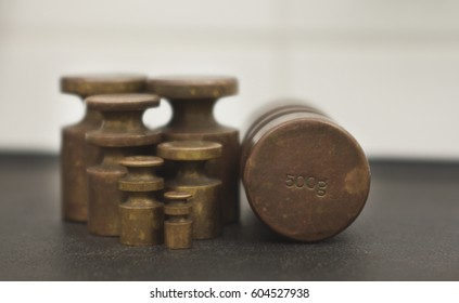 Old fashion traditional scale iron weights showing 500 grams.