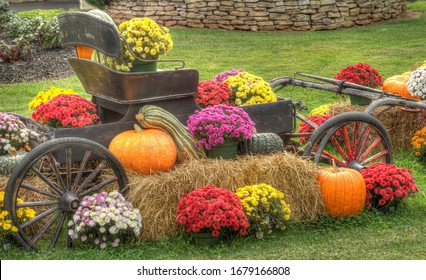 An old fashion wagon with mums, pumpkins and gourds