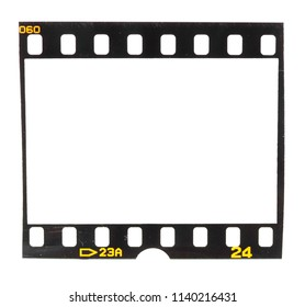 Old fashioned 35mm filmstrip or dia slide frame isolated on white background. Real analog film scan with signs of usage.