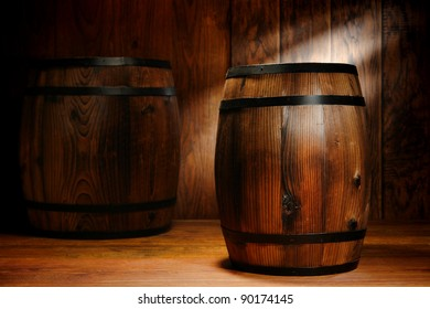 Old fashioned antique whisky wood barrel and wine keg container in a nostalgic American antique brown wooden warehouse decor