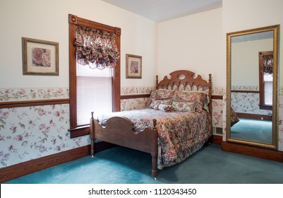 Old Fashioned Bedroom with Antique Walnut Bed
