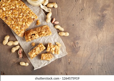 Old Fashioned Buttermilk Penuche Fudge candy with peanuts on a wooden table. Close up top view with copy space
