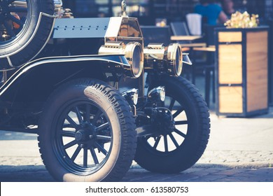 old fashioned car on the street of Torun, Poland