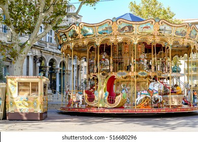 An old fashioned carousel sits in the middle of the square in Avignon, France.
