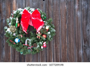 Old fashioned  Christmas wreath western style wreath on old wood background