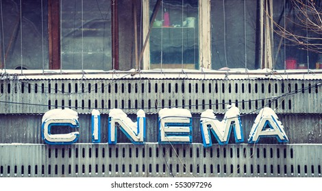Old fashioned cinema sign in Bucharest dating from a long time ago forgotten cinema theater