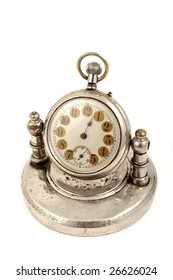 An old fashioned clock on white background