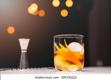 Old fashioned cocktail drink on the counter bar.