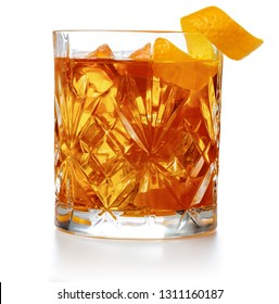 old fashioned cocktail garnished with orange twist isolated