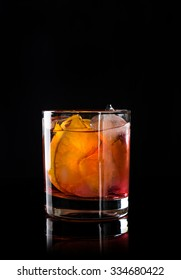 Old fashioned cocktail on the black background