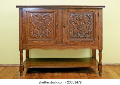 Old fashioned dresser with ornate doors