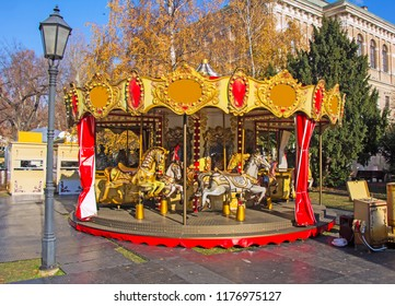 Old fashioned french carousel with horses