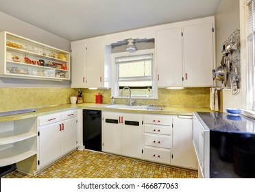 Old fashioned kitchen with white cabinets, cupboard and  linoleum floor. Northwest, USA