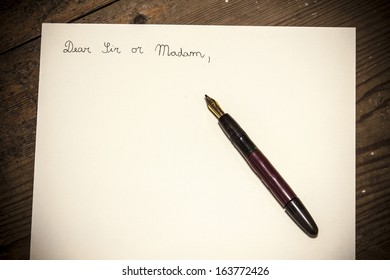 Old fashioned letter with a pen