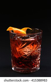 Old fashioned Negroni cocktail on the black background.