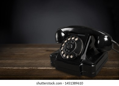 Old fashioned phone  on background