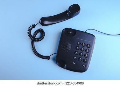 Old fashioned phone on blue background