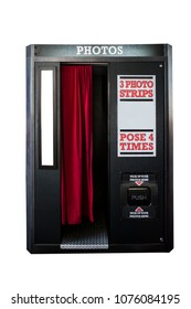 An old fashioned photo booth that can be found at arcades and carnivals.