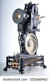 Old fashioned projector on isolated background.