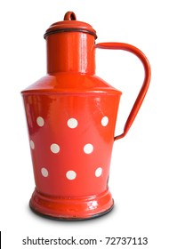 Old fashioned rural style red metal milk jug with white dots, lid and handle isolated on white background.