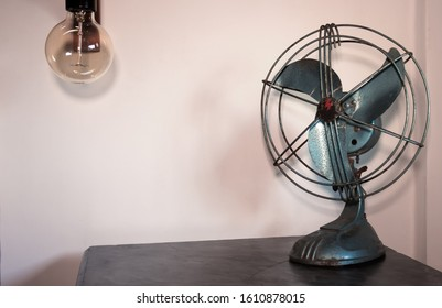 Old fashioned and rusty fan used as a decoration element for a night table in a bedroom. Design and style. Ideas for home.