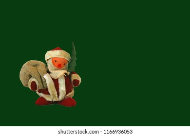 Old fashioned santa claus from the 60's on a green background