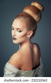 Old fashioned sexy woman with beautiful creative hairstyle