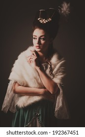 Old fashioned sexy woman with fur cape