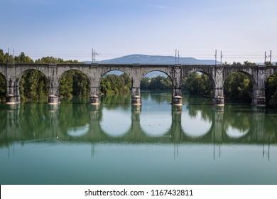 Old fashioned stone bridge on Soca River in Gorizia, Friuli Venezia Giulia, Italy