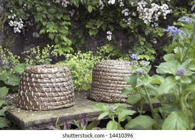 old fashioned straw beehives