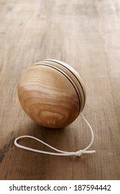 An old fashioned style wooden yoyo a retro childhood concept
